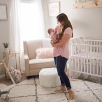 Newborn nursery with cozy chic home decor and mom adoring newborn baby Gainesvile newborn photographer