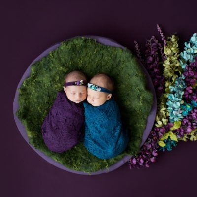 Newborn Twin Girls with Teal and Purple Flower Baby Setup in Gainesville Florida