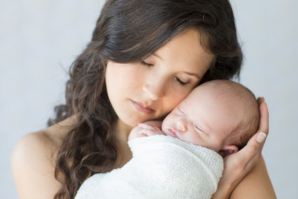 Mom totally in love with newborn baby girl photo Gainesville Florida