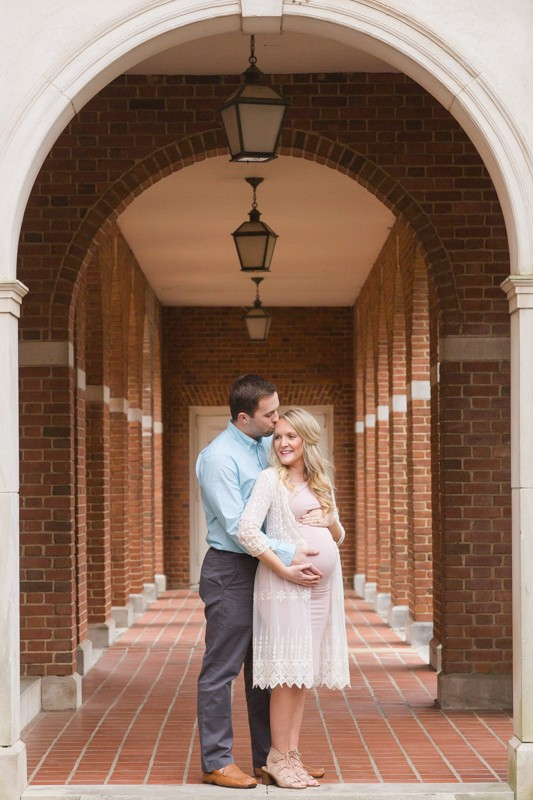 Pregnant Mom in pink gown lace and Dad posed in brick archwat Birmingham Alabama Maternity Photos