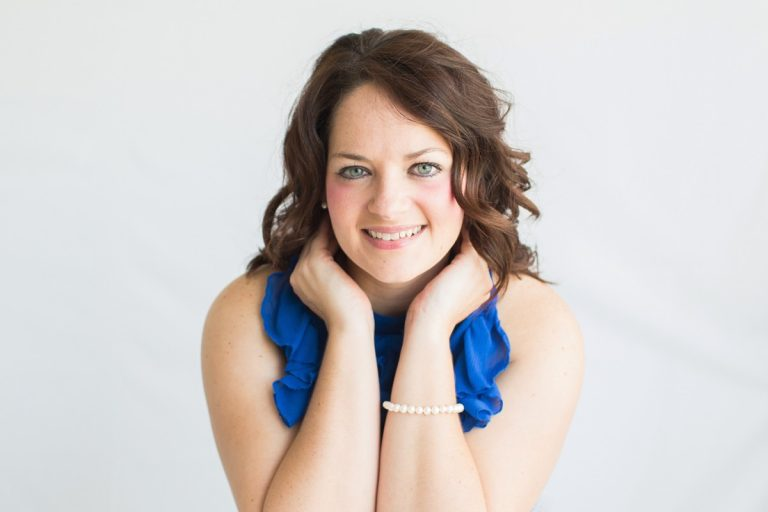 Beautiful woman big blue eyes brown curly hair smiling celebrates beauty with glamor photos royal blue sleeveless ruffle dress Gainesville Florida Womens Portraiture