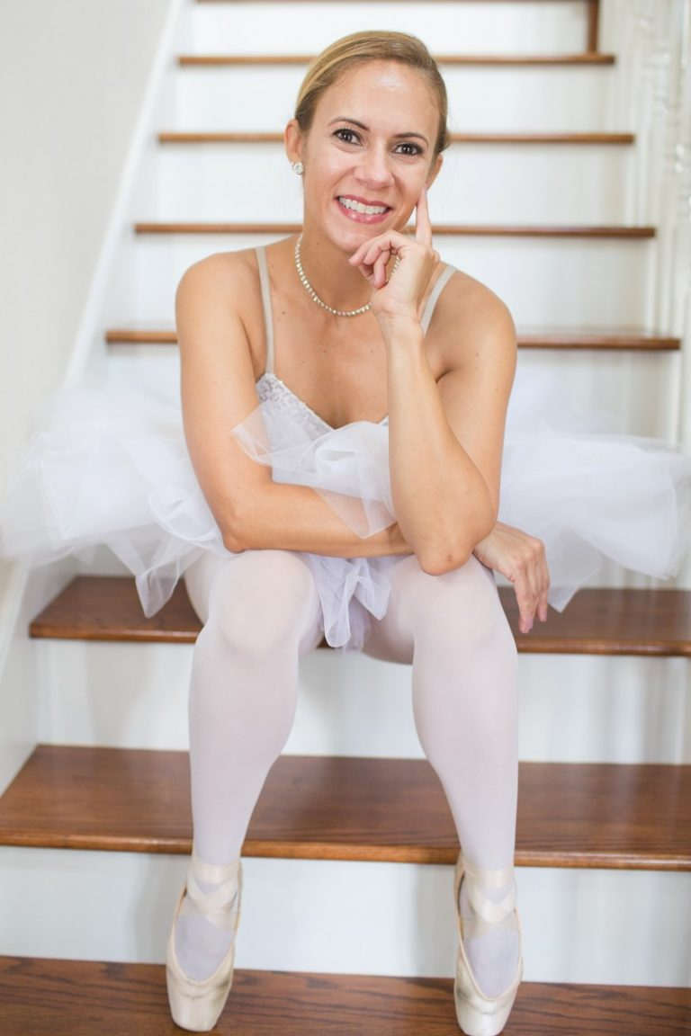 Beautiful woman big brown eyes smiling celebrates beauty with dance posed on steps wjte tutu jewels pink pointe shoes Gainesville Florida Womens Portraiture