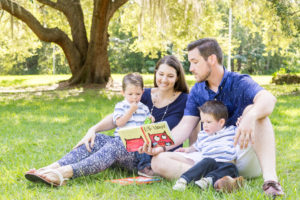 Reading Favorite Book to Two-Year-Old Twin Boys for Family Portrait taken in Tioga, Florida