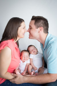 Family with Newborn Twin Boys Posed for Family Portrait taken in Gainesville, Florida