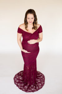 April in Lace Burgundy Maternity Gown Glancing at her Round Belly Gainesville Florida