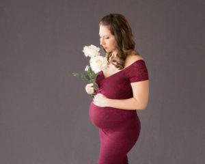 April with Maternity photos carrying Twin girls white roses in Gainesville Florida