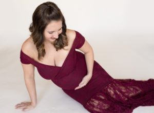 April with Maternity photos in burgundy lace gown carrying Twin girls in Gainesville Florida-14