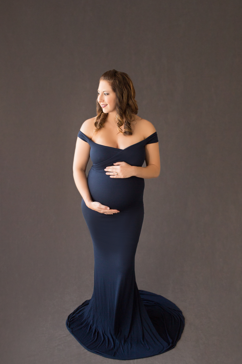 April with Maternity photos in navy gown carrying Twin girls in Gainesville Florida-17