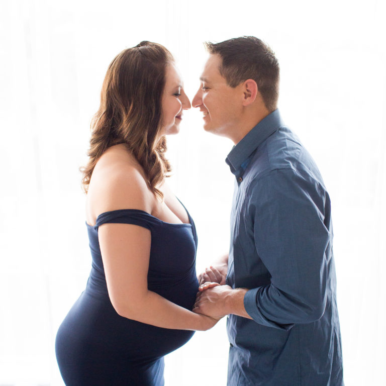 April and James back lit Maternity photos in navy gown carrying Twin girls in Gainesville Florida-4