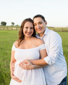 April and James outdoor Maternity photos carrying Twin girls in Gainesville Florida