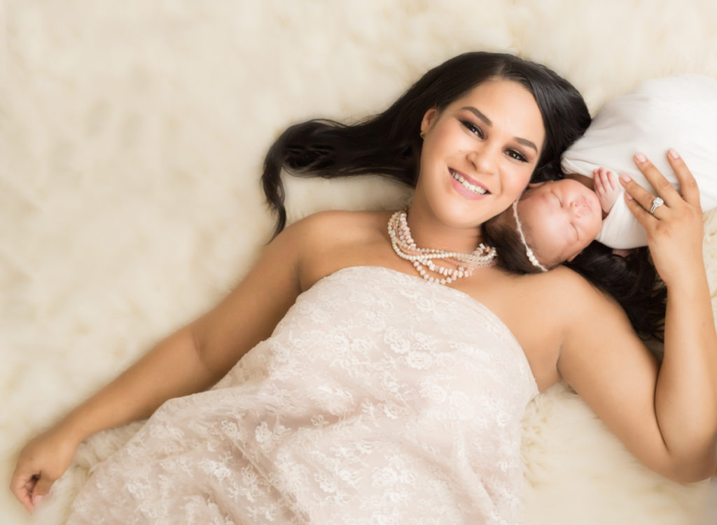 Babygirl with glamorous mom in Newborn Photosession on cream fur