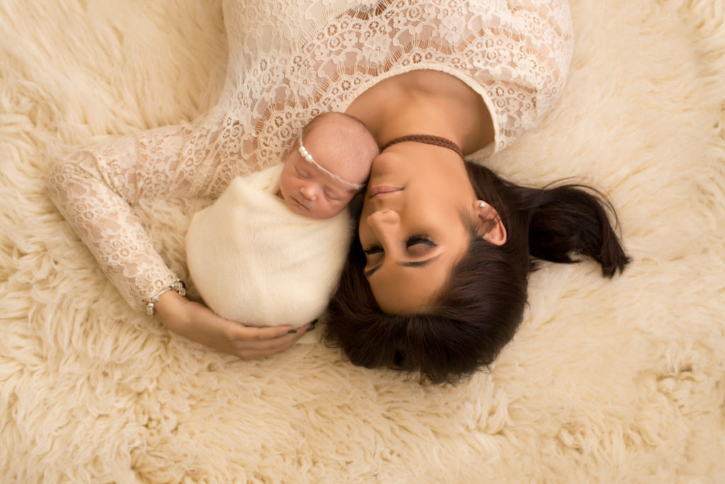 Baby girl Charleigh and beautiful mom on fur flook cuddling in Gainesville Florida