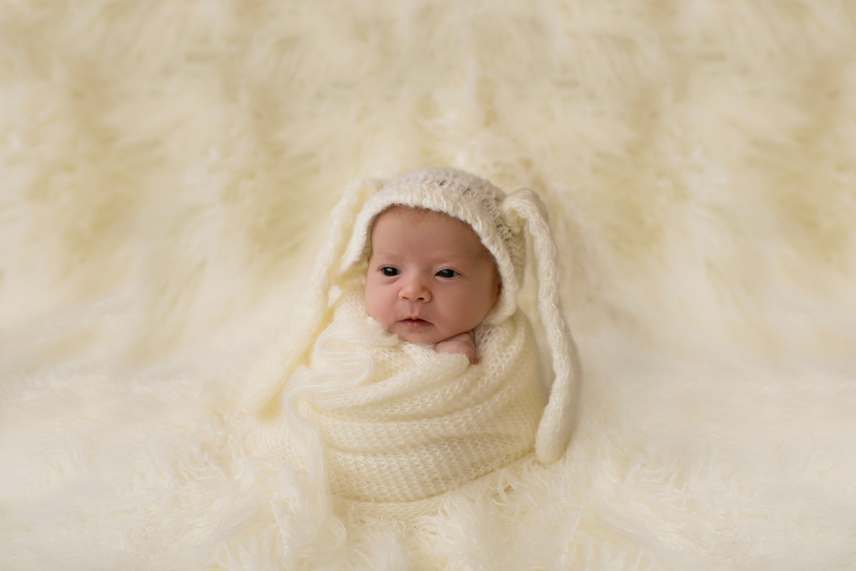 Baby girl Charleigh potato sack and bunny bonnet on cream fur in Gainesville Florida