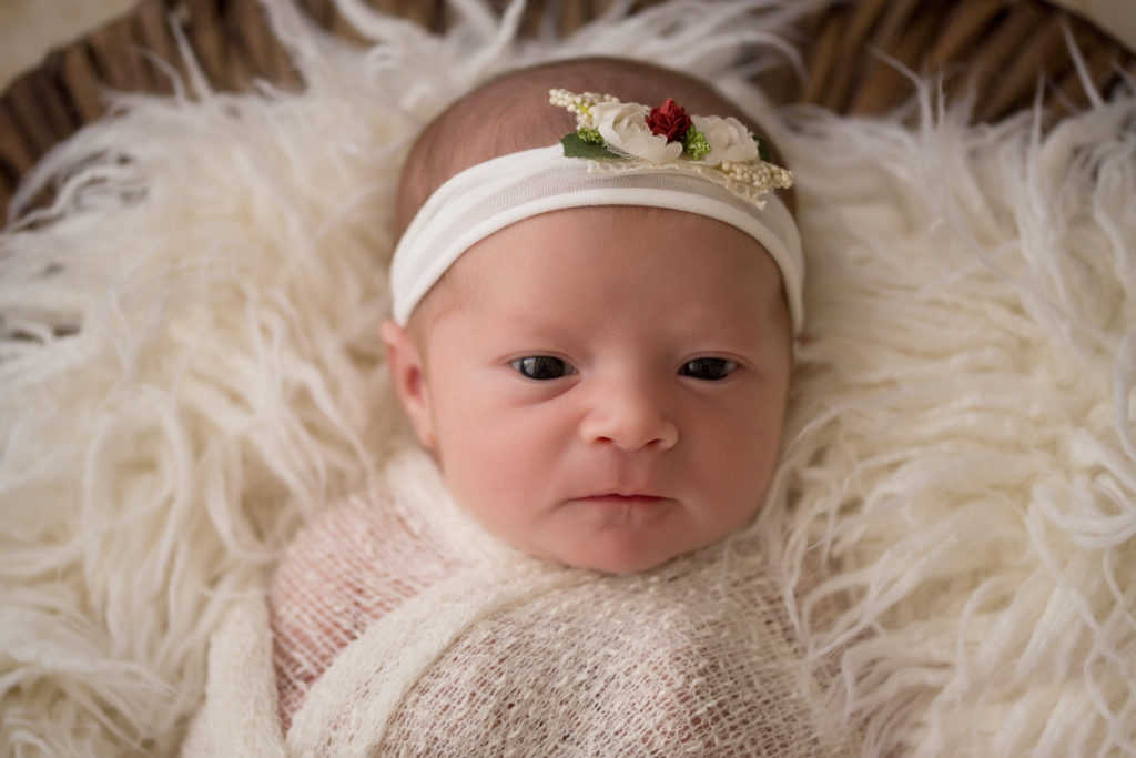 Baby girl Charleigh wrapped in cream eyes wide open in Gainesville Florida
