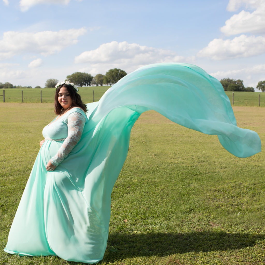 Maternity pale mint green gown tossed in wind outside photos in Alachua Florida