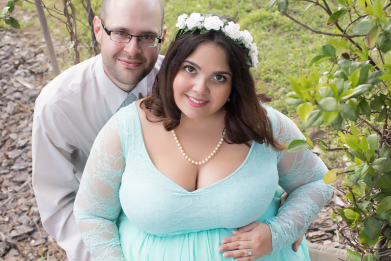 Maternity Outdoor Photos mom in Mint Gown with dad under arbor in Alachua Florida