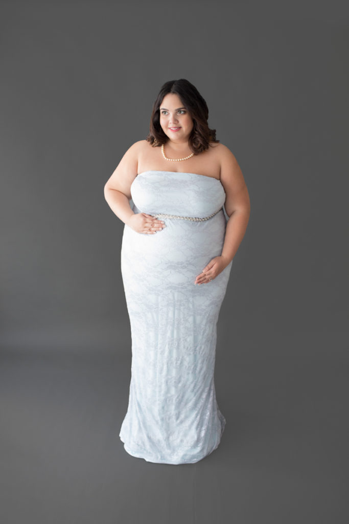 Maternity Indoor Photos of Pregnant Adelis in Blue Lace gown and Pearls in Alachua Florida