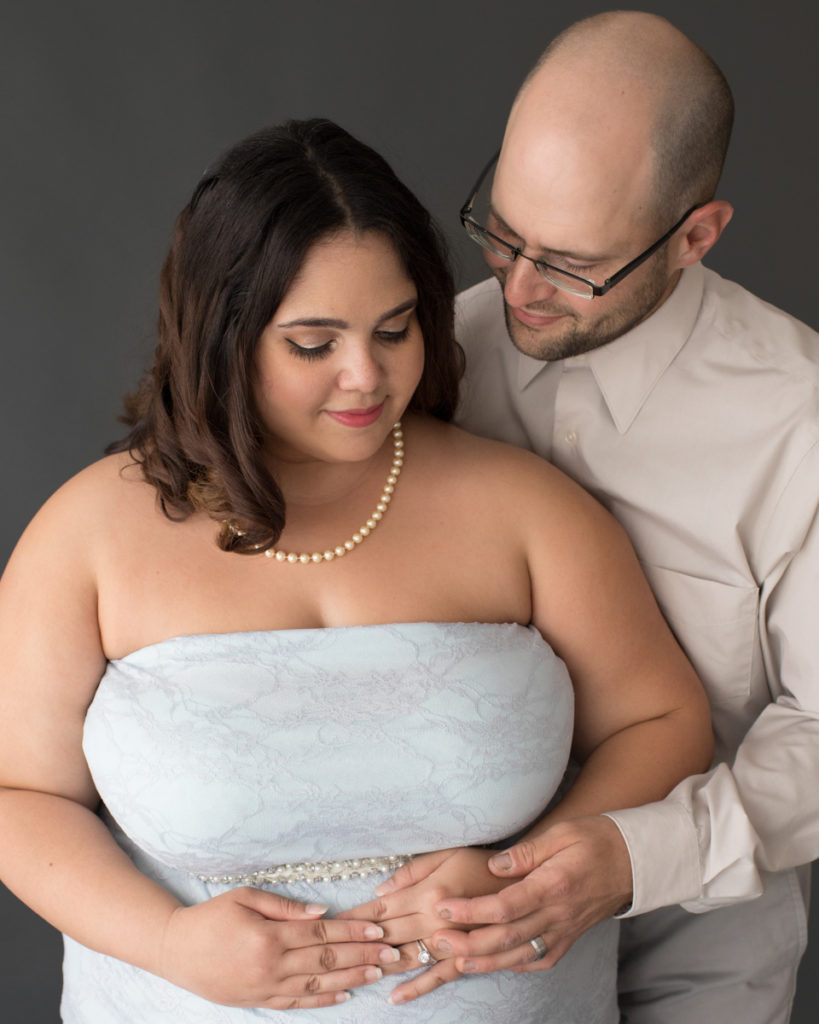Maternity Indoor Photos of Pregnant Adelis in Blue Lace gown and Pearls with husband in Alachua Florida