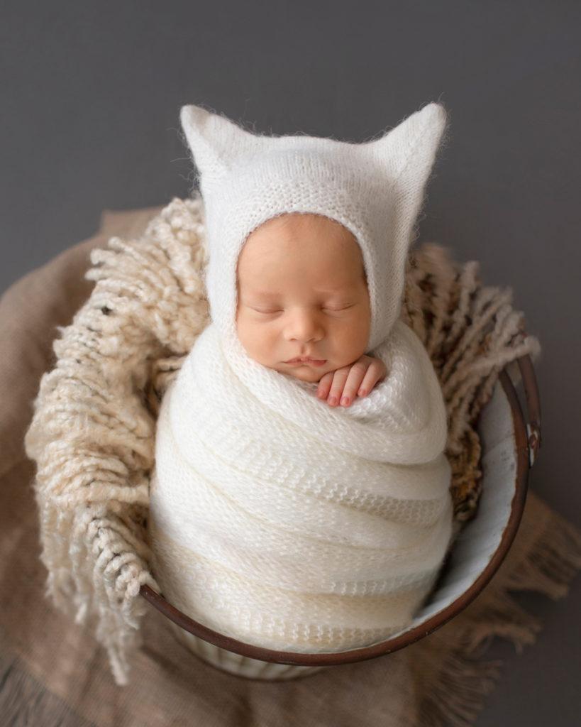 Newborn Baby Rowan wrapped in white potato sack posed in bucket Gainesvile Florida Photos