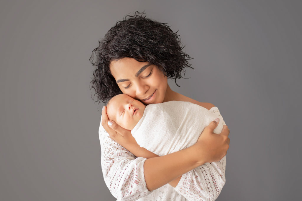 Big sister cuddling newborn baby Rowan Gainesvile Florida Photos