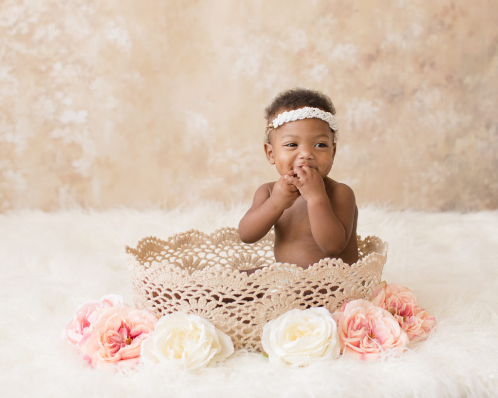 Adorable Rose One Year Old in lace basket with pink and white flowersBaby Girl Photos Gainesville Florida