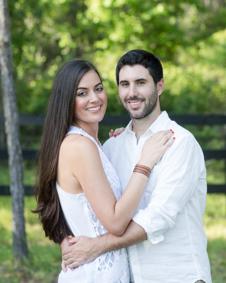 Gorgeous married couple dark hair dressed all in white light filled outside photo Williston Florida