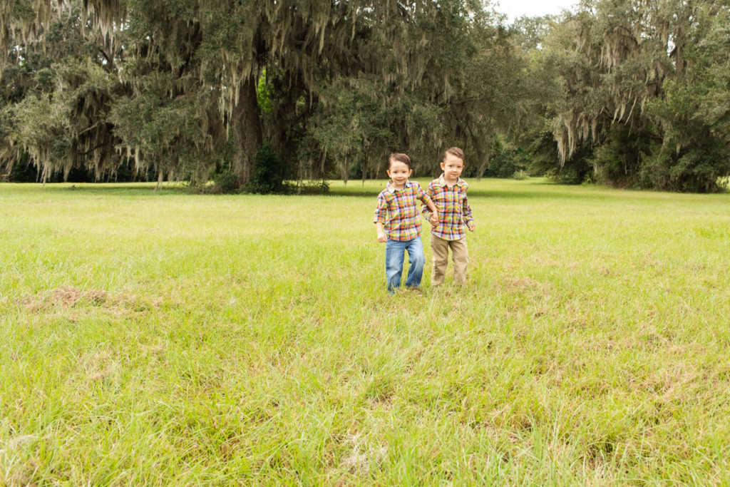 Family Photos with Three Year Old Twin Boys hand in hand running through field at Horseshoe Farm Alachua Florida-2