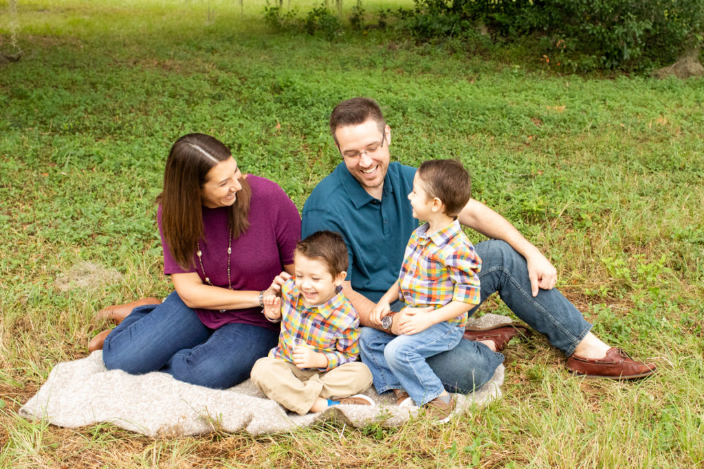 Family Photos with Three Year Old Twin Boys sitting on blanket and laughing at Horseshoe Farm Alachua Florida