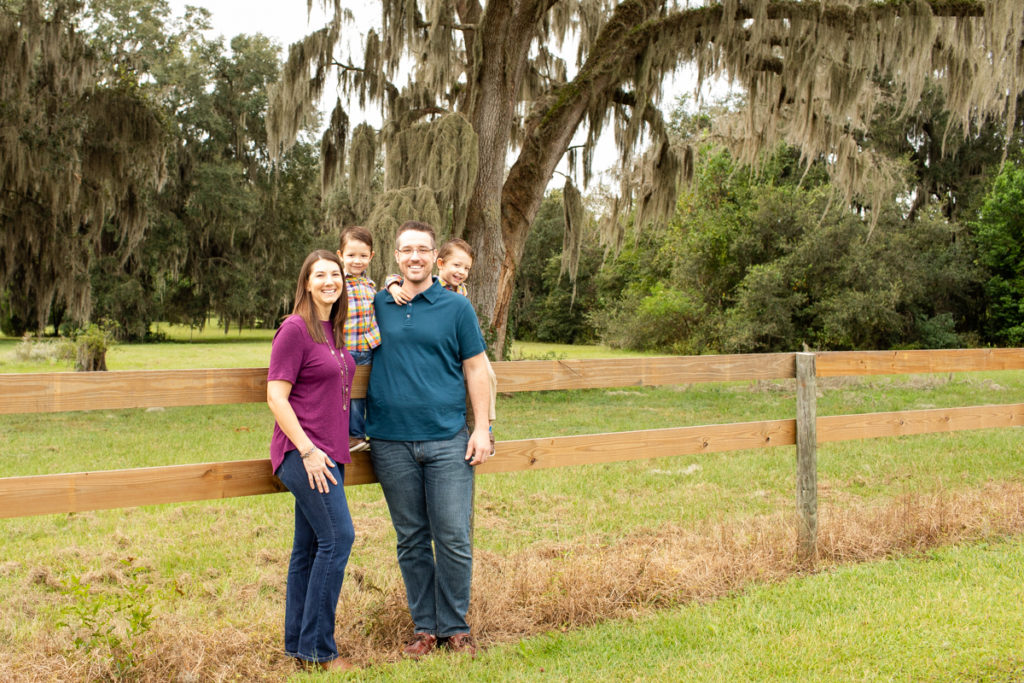 Family Photos Three Year Old Twin Boys leaning on fence at Horseshoe Farm Alachua Florida