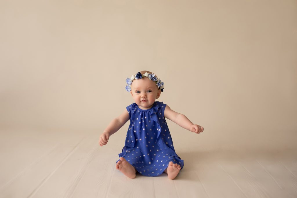 beautiful baby photos 6 month girl wears blue polka dot dress and floral crown