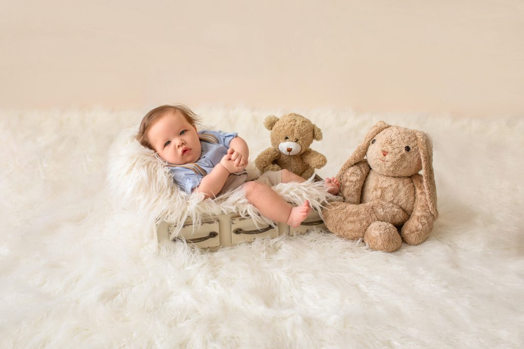 3 month baby pictures khaki shorts button up collared shirt suspenders with favorite teddy bear eyes to camera