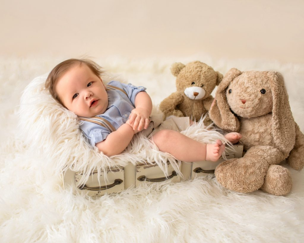 3 month baby pictures khaki shorts button up collared shirt suspenders teddy bear mom's stuffed bunny little baby grin
