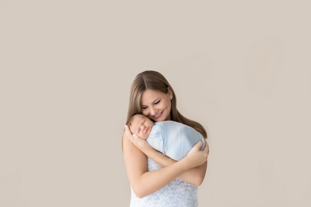 Delighted new mom snuggles baby boy Gabe newborn photography