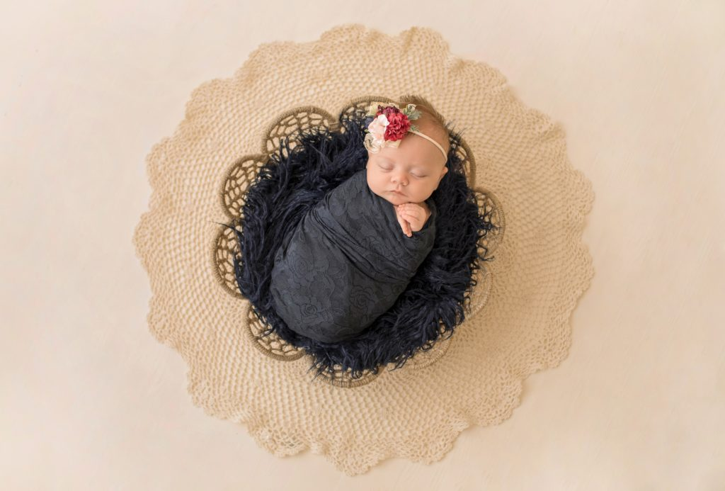 mini newborn photo session girl with navy lace in basket floral headtie Gainesville FL
