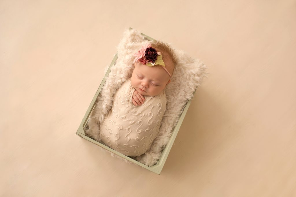 newborn photo session girl ivory lace in sea green wooden crate floral headtie Gainesville FL