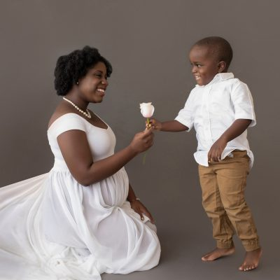 maternity portrait boy hands pink rose to mom for baby sister white chiffon maternity gown Gainesville FL