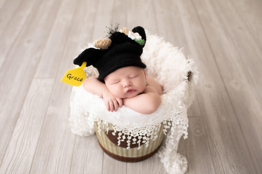 newborn in a bucket