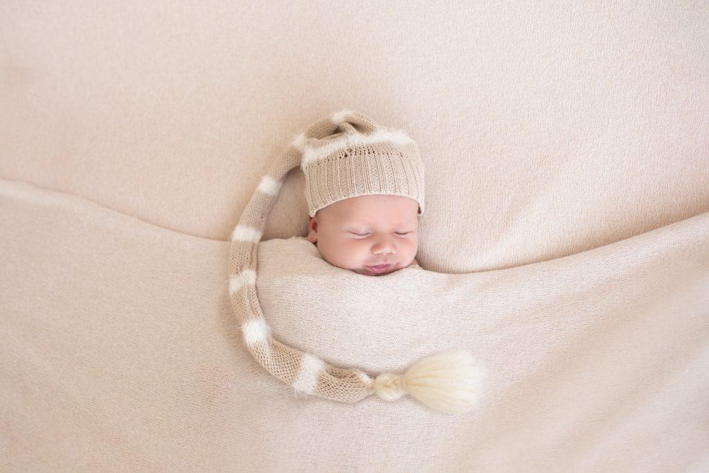 newborn photo with hat
